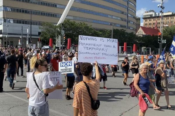 Demonstators hit the streets against vaccine passports