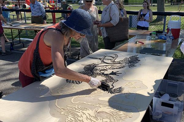 Successful steamroller printmaking event pulls a crowd